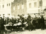 Poland, auctioneers with miscellaneous market wares at Grodzick market