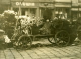 Poland, cart of farm produce at market