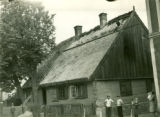 Poland, wooden house with rye thatch roof