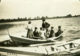 Lithuania, several people docking in canoe