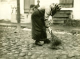 Poland, woman street cleaner