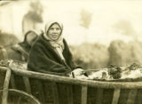 Belarus, woman in wagon at market