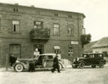 Poland, cars parked on street in front of restaurant