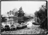 Belarus, canoes docked at fishing settlement with conical net