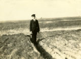 Belarus, man standing in ditch in field of rye
