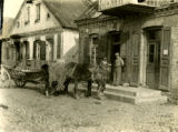 Poland, horse and wagon parked in front of building