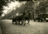 Lithuania, carriage with two horses on cobbled road
