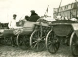 Belarus, wagons filled with wood planks at market