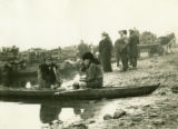 Belarus, two men sitting in canoe at market