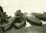 Belarus, people in canoes at market waterfront