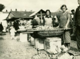 Belarus, women at market stall