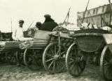 Belarus, market wagons filled with wood planks