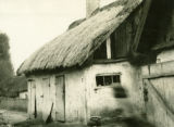 Poland, plastered wood house with thatched roof