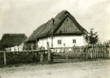 Poland, wooden house painted white