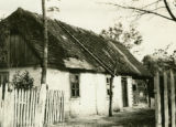 Poland, house with half thatched roof and shingles