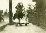 Ukraine, three women talking down road