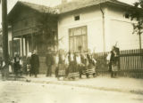 Ukraine, people walking in front of house