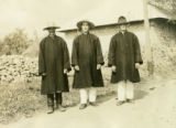 Ukraine, three men standing along road