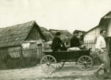 Ukraine, people in wagon in town
