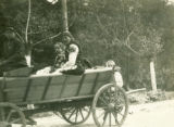 Ukraine, mother and children in cart