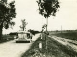 Poland, car and wagon on different types of roads