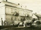 Ukraine, wagons parked outside two story building