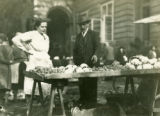 Ukraine, two people standing at market stall