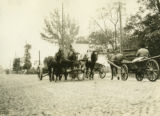 Poland, horse drawn wagons on cobbled road