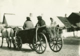 Ukraine, people in horse drawn wagon