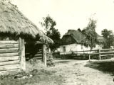 Ukraine, close up of log barn and thatched roof