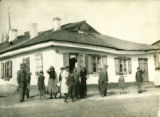 Ukraine, people standing in front of old house