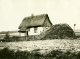 Ukraine, plastered house with thatched roof