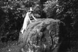 Guatemala, Harriet Platt standing on ancient stone carving at Quiriguá