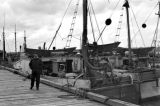 Canada, John Forman [Foreman] on dock with fishing boats in Nova Scotia