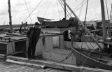 Canada, John Forman [Foreman] looking at fishing boats in Nova Scotia
