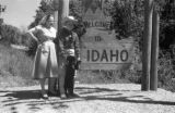 United States, Sandra and John Forman at 'Welcome to Idaho' sign