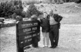 United States, Harrison and John Forman at sign for Logan Pass at Continental Divide