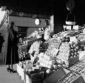 United States, woman at fruit at stand in Manhattan