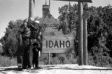 United States, Harrison and John Forman at 'Welcome to Idaho' sign