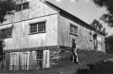 United States, John Forman looking at historic building in Old Sturbridge Village