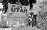 United States, Harrison and John Forman at 'Welcome to Utah' sign