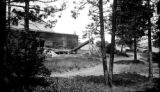 United States, view through trees of lakeside icehouse in Marquette