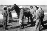 United States, King Muhammad V inspecting horse at King Ranch in Kingsville