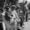 Mexico, people sitting on bench in park in Toluca de Lerdo