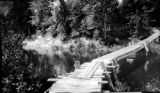 United States, wooden pedestrian bridge over the Anna River in Munising
