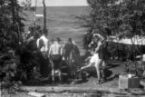 United States, Platt party cooking dinner on shore of Lake Superior