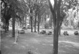 Canada, cars parked near grass court at Hollywood Lodge in Ontario Province