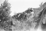 United States, Harriet and Nancy Platt climbing down hill in Michigan
