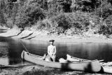 Ontario, Gil in canoe at camp below upper Floodwood River
