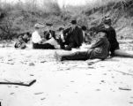 Maryland, group seated on sand at Chesapeake Beach